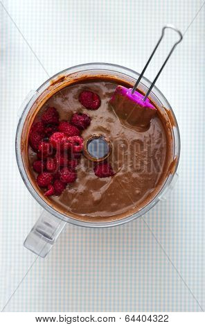 Making Cake - Mixing Chocolate Batter With Raspberries