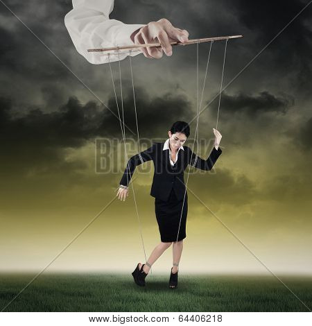 Businesswoman Hanging On String 1
