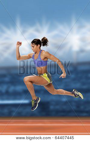 African American sprint runner inside stadium at night