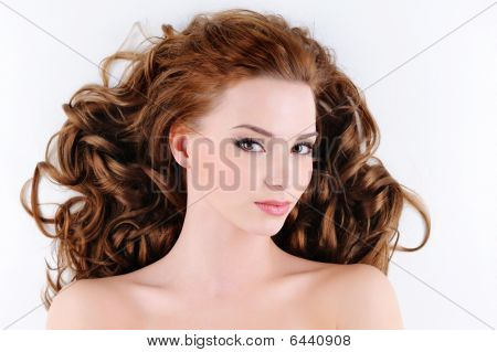 Attractive Young Woman With Curly Hairs