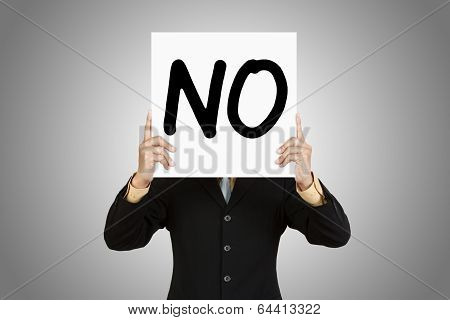 Businessman Show Wording No On Paper Board