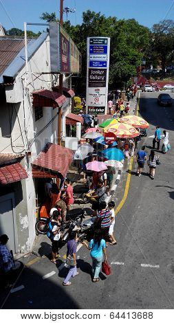 Melaka, Malaysia- April 19, 2014: Customers Queue For Melaka Famous Chicken Rice In Jonker Street.