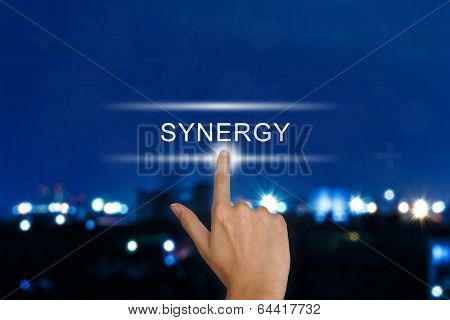 Hand Pushing Synergy Button On Touch Screen