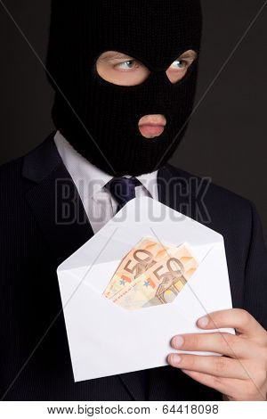 Bribery Concept - Masked Man In Suit Holding Envelope With Money