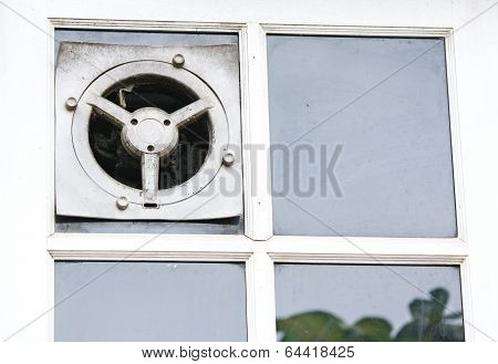 Exhaust fan in the kitchen is embedded in the glass wall