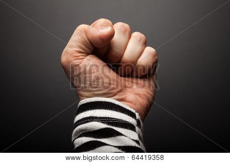 Close-up Photo Of Sailor Fist  On A Dark Background