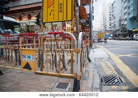 HONG KONG - NOVEMBER 14, 2012: Drying fish on the street in Sheung Wan district. Trade in shops dried seafood a very common type of business in Hong Kong,  as seafood are popular with the locals.