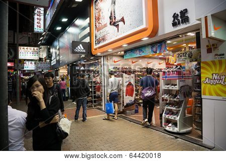 HONG KONG - NOVEMBER 14, 2012: Small shops working in the evening time in Mong Kok district very popular tourists and residents of Hong Kong.