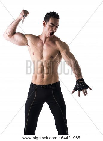 Muscular Young Man Holding Big Knife Ready To Stab