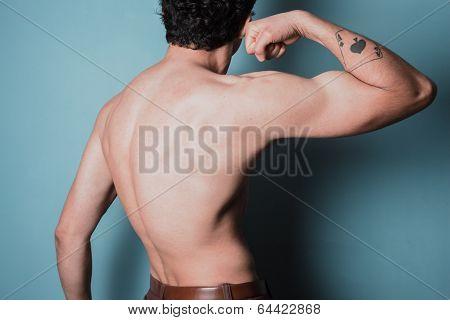 Muscular Young Man Flexing His Bicep