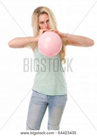 Young Blond Woman Inflating Balloon