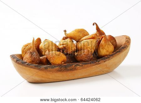 dried figs served on the wooden tray