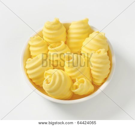 overhead view of bowl with yellowish butter curls