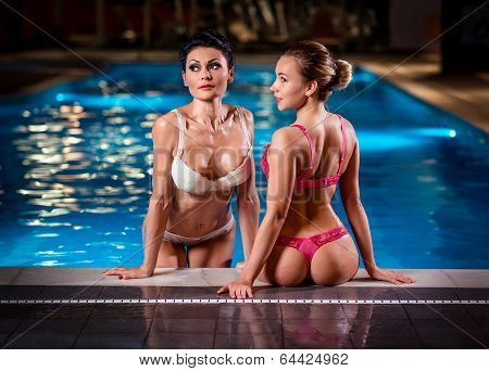 Two Beautiful And Sexy Ladies Posing Near Pool