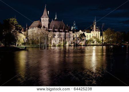 Night View Of Vajdahunyad Castle From Lakeside. Budapest, Hungary