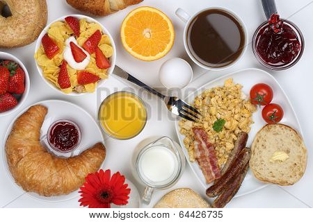 Breakfast With Scrambled Eggs, Fruits, Coffee And Orange Juice From Above