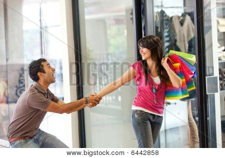 Man Keeping A Woman From Entering A Store