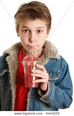 Child Drinking Fresh Fruit Juice Through A Straw