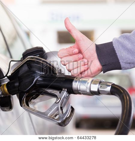 Petrol being pumped into a motor vehicle car.