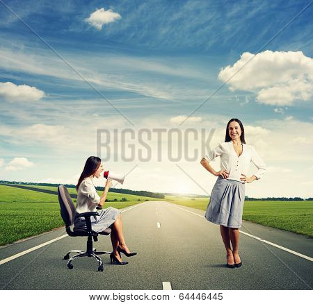 angry woman and smiley calm woman on the road