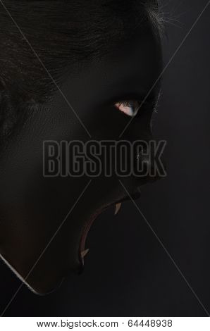 Screaming Woman With Fangs In Black Paint