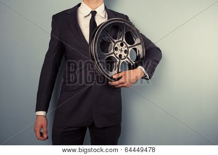 Young Producer With Film Reel