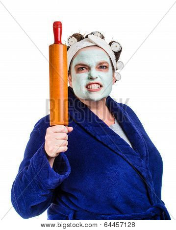 Mean And Ugly Housewife With Facial Mask, Hair Rollers And Rolling Pin Isolated On White