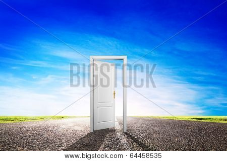 Open door on long empty asphalt road, highway towards sun. Hope, success, new way concepts etc.