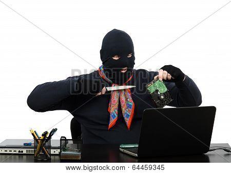 Burglar Holding A Knife And Hard Disk Speaking On Skype