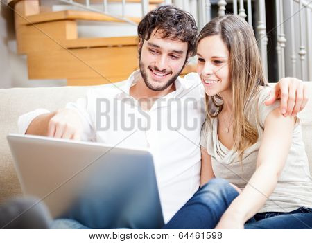 Young couple using a laptop computer