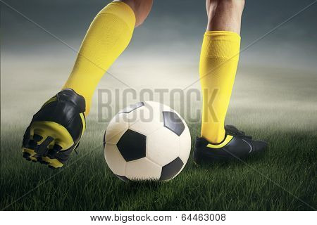 Soccer Player Dribbling The Ball At Field