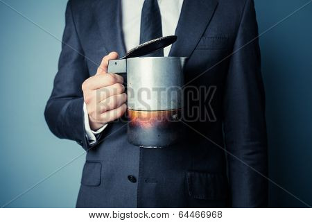 Man In Suit Holding A Moka Pot