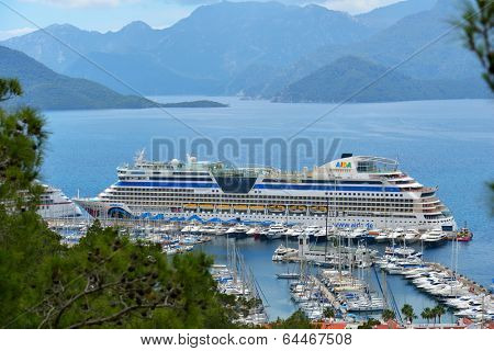 MARMARIS, TURKEY - MAY 1, 2014: Cruise ship AIDAdiva in the port of Marmaris. AIDA ships cater to the German-speaking market, and has 94% average guests satisfaction rate