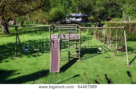 Children Playground On Green Grass