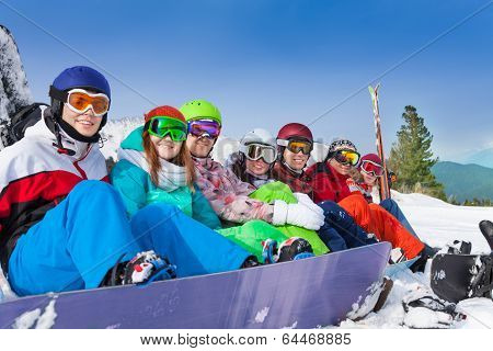 Friends with snowboards wearing ski googles