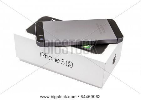 Ostersund, Sweden - May 2, 2014 : iPhone 5s and the box isolated on white background. Apple IPhone is one of the most popular smart phones in the world.