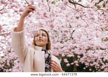 Beautiful Young Lady Photographing Nature With Her Mobile Phone