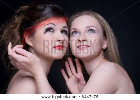 Closeup Portrait Of Two Girls: Good & Evil