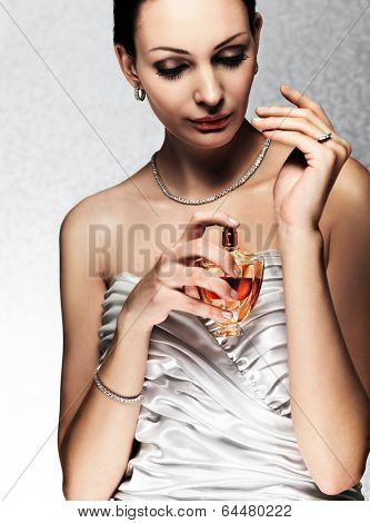 elegant bride applying perfume on her wrist