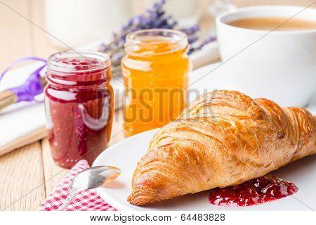 Croissants with raspberry and orange jam.