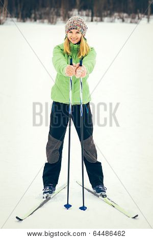 Young Woman With Ski Happy Smiling Face Winter Time Snow Skiing Sport And Healthy Lifestyle Concept