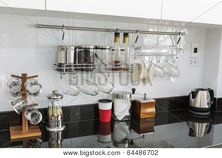 Kitchen cabinets with coffee corner in modern home living room.