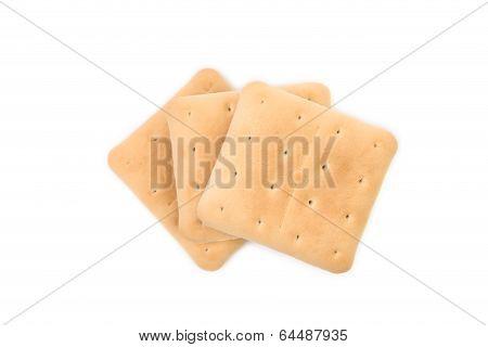 Saltine soda cracker isolated on white.