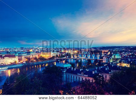 Vintage retro hipster style travel image of travel Prague concept background - elevated view of bridges over Vltava river from Letnaa¡ Park. Prague, Czech Republic in twilight