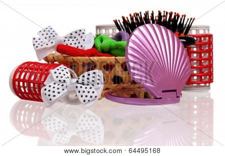 Red hair curlers and hairbrush isolated on white background