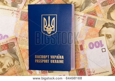 International Ukrainian passport on Hryvna banknotes background