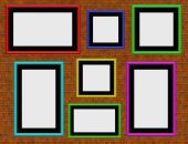 Brick Wall With Colourful Empty Photo Frames