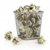 picture of depreciation  - Money in a basket on a white background - JPG