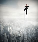stock photo of ascending  - Businessman that looks far on a stair - JPG