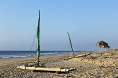 pic of raft  - Wooden raft with mast on the sandy beach of the popular small town of Mancora in Northern Peru  - JPG